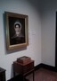 George Caleb Bingham, Mary Snell McBride, 1837 at the Jackson County Art Museum in Independence, Missouri, with the original brooch she wore in the painting in a display case on the table beneath her portrait